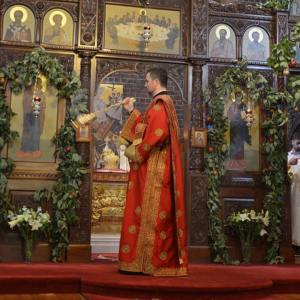 Deacon censing iconostasis